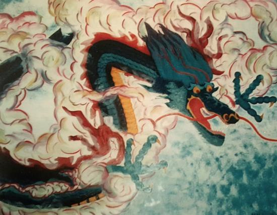 A colorful dragon flying in the blue sky